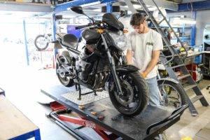 mechanic-servicing-bike